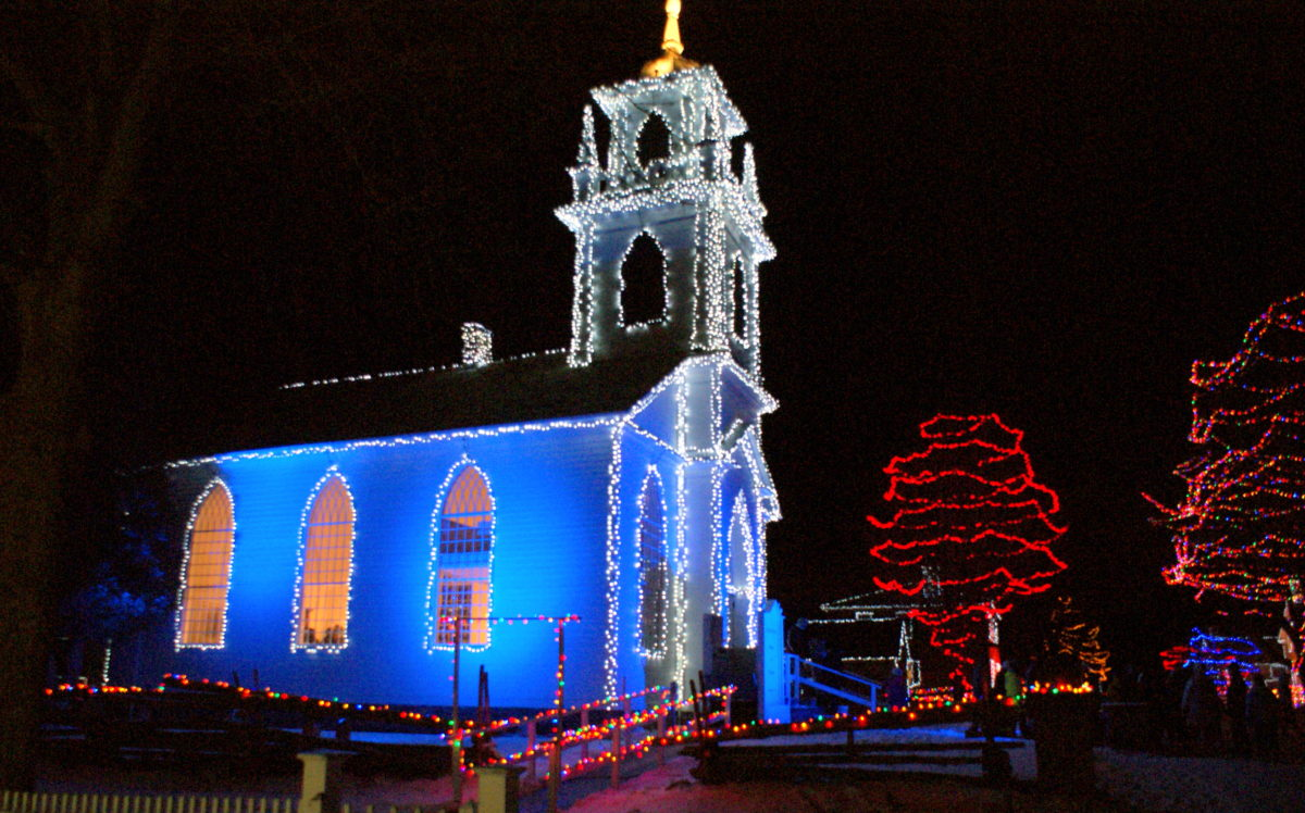 Christmas lights adorn church Alight at Night in Upper Canada Village